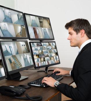 security guard monitoring cctv
